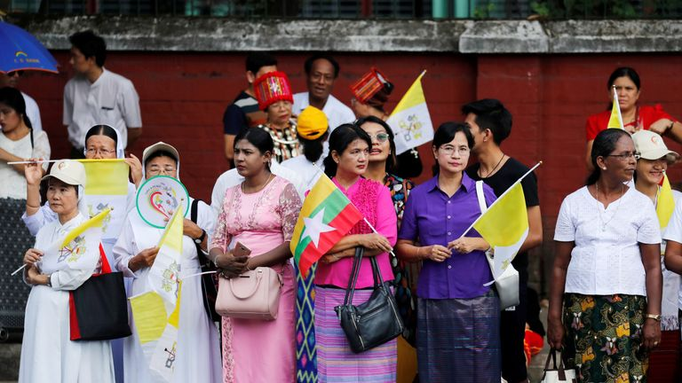 People gather outside the the residence of Cardinal Charles Maung Bo, Archbishop of Yangon