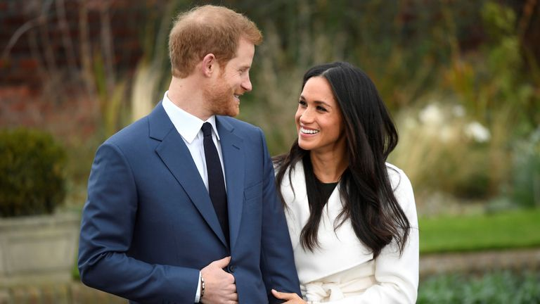 Prince Harry poses with Meghan Markle