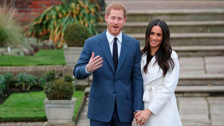 Prince Harry and his fiancée Meghan Markle pose for a photograph in the Sunken Garden at Kensington Palace