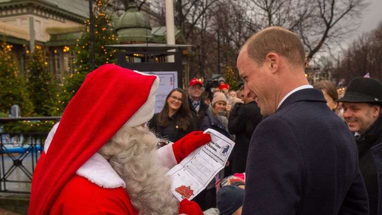 The Duke of Cambridge hands Prince George's Christmas Wish List to a man dressed as Santa Claus as he visits Esplanade Park's Christmas market in Helsinki, on the second day of his tour of Finland. PRESS ASSOCIATION Photo. Picture date: Thursday November 30, 2017. William is making his first official visit to the Nordic nation which is celebrating the 100th anniversary of its independence. See PA story ROYAL William. Photo credit should read: Dominic Lipinski/PA Wirere