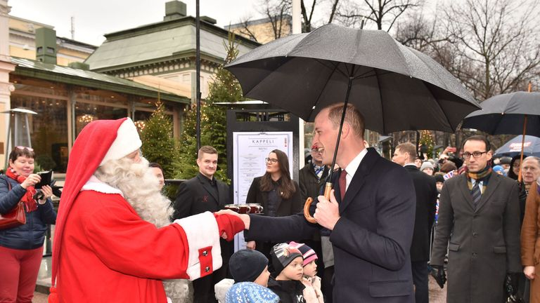 The Duke of Cambridge smiles after handing over the wish list in Helsinki