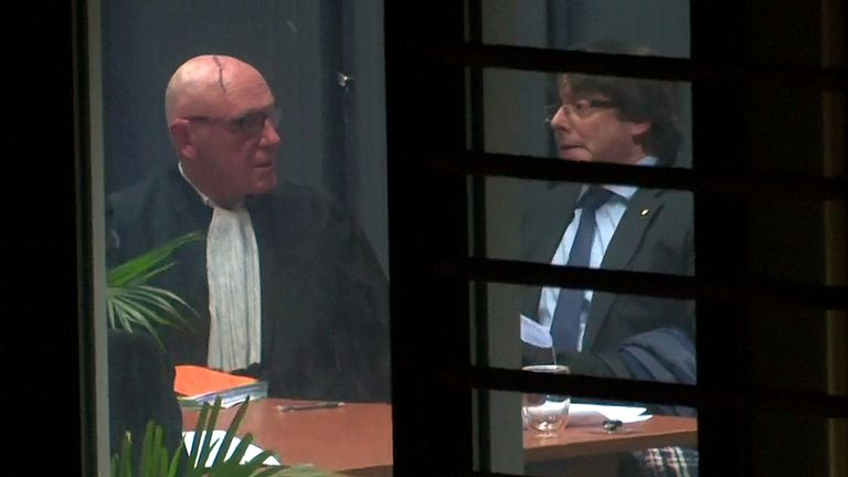 Mr Puigdemont (R) pictured speaking to his lawyer in Brussels