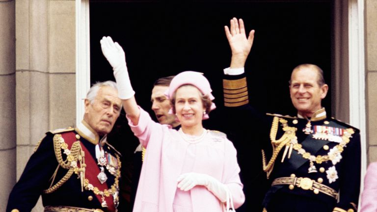 June 1977: SILVER JUBILEE CELEBRATIONS 1977: (l-r) Earl Mountbatten of Burma, the Queen and the Duke of Edinburgh wave from the balcony of Buckingham Palace after the Silver Jubilee procession.
