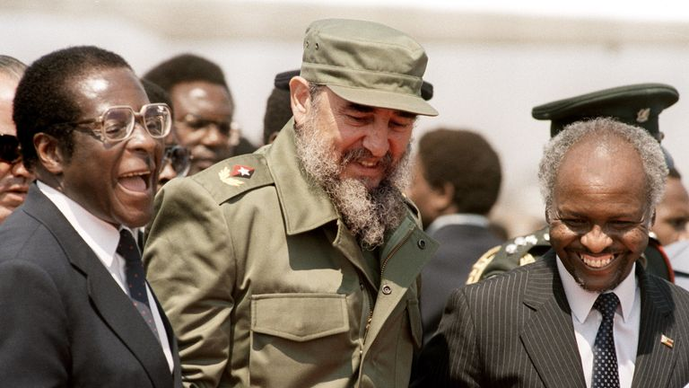 1986: Cuban President Fidel Castro (C) shares a laugh with Zimbabwean President Canaan Banana (R) and Zimbabwean Prime Minister Robert Mugabe (L) as he arrives in Harare