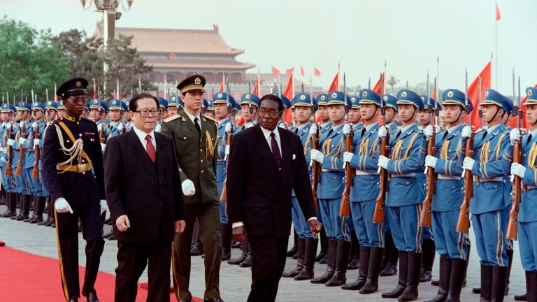 Chinese President Jiang Zemin (L) welcomes Robert Mugabe (R) with a Chinese honour guard during a welcoming ceremony outside the Great Hall of the People on 7 May 1993 in Beijing