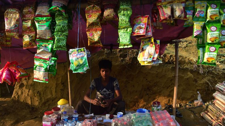 A Rohingya refugee shop keeper waits for customers