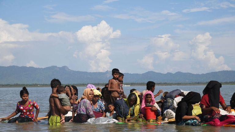 Rohingya Muslim refugees sail a makeshift raft made from jerrycans and bamboo across the Naf River into Bangladesh at Sabrang, Teknaf district
