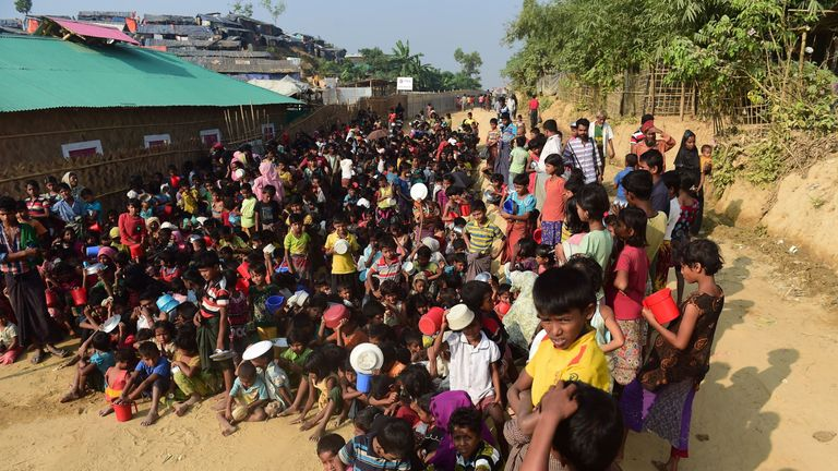 Rohingya refugee children wait for food in the Thankhali refugee camp