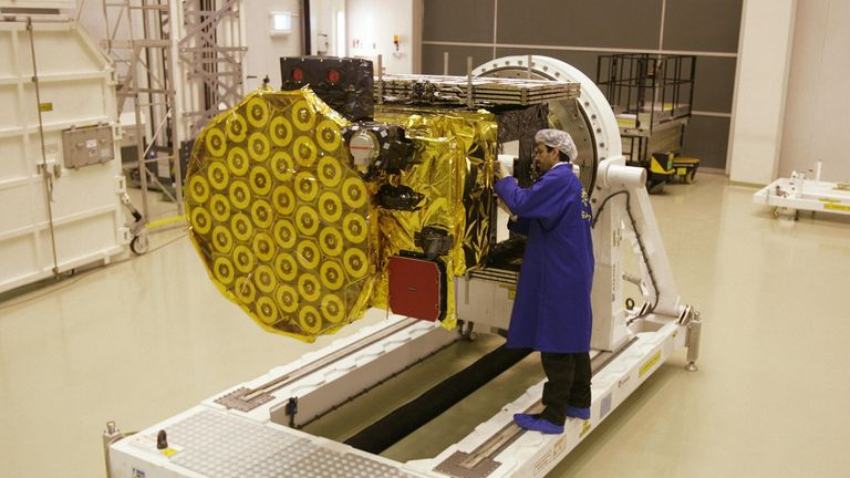 A European Space Agency technician works on the Giove B satellite, which forms part of the Galileo network