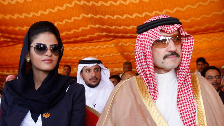 Saudi Prince al-Waleed bin Talal and his wife Princess Amira al-Taweel attend a ceremony for the opening...