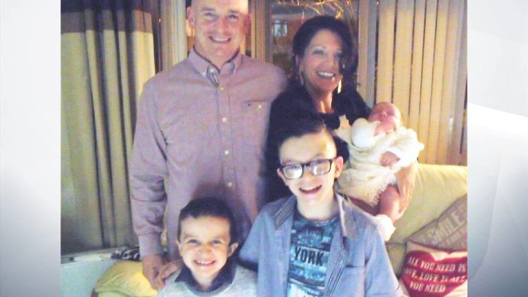 Mr McGrotty pictured with his partner Louise, sons Mark (R) and Evan, and daughter Rionaghac-Ann