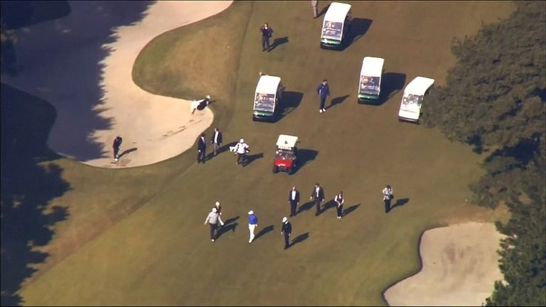 Moment Japanese PM Shinzo Abe apparently tumbles into a bunker while playing golf with Donald Trump