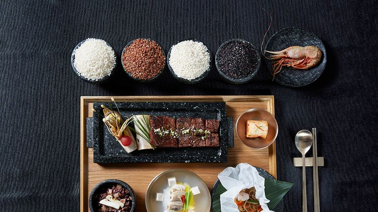 An image of the grilled beef course with 360-year-old soy sauce and a prawn from disputed waters. Pic: Blue House