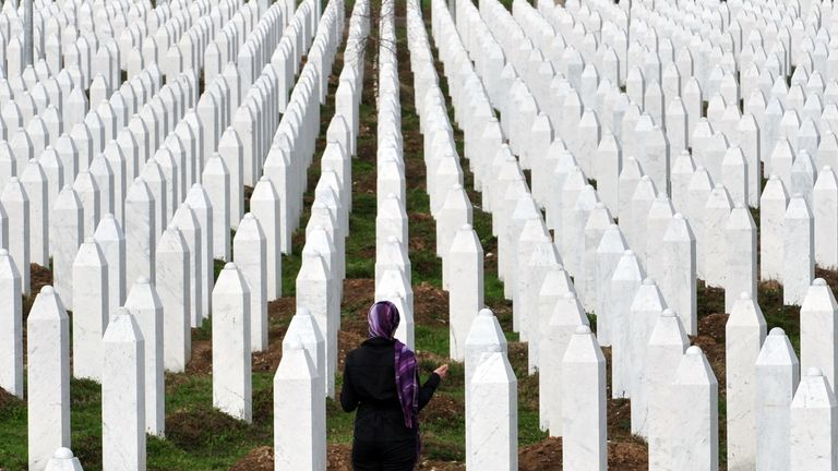 A woman looks at the graves of the thousands massacred in Bosnia