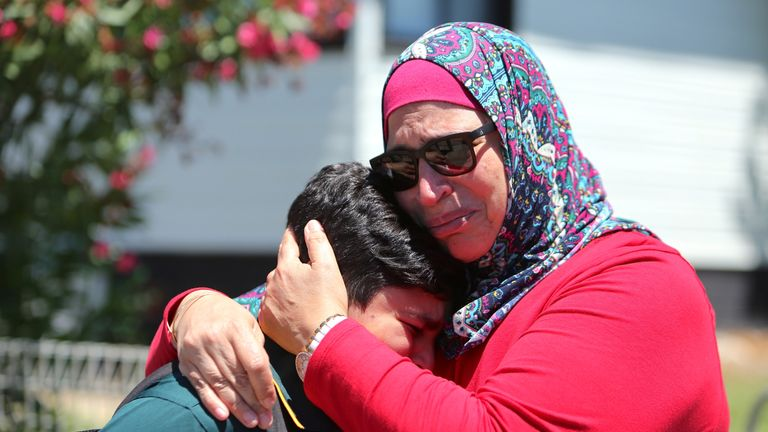 A woman and her son weep in the aftermath of the fatal crash