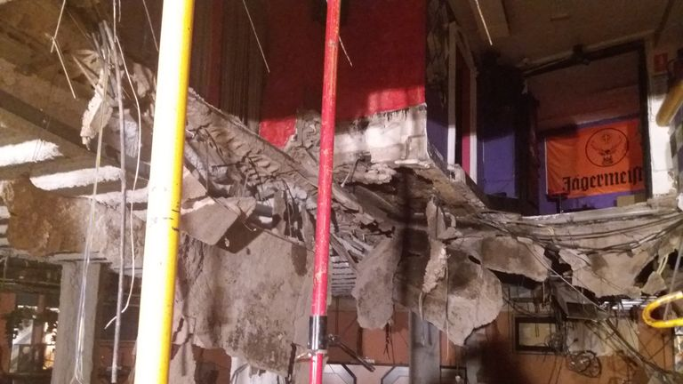 Debris litters the floor of the bar's basement after the collapse