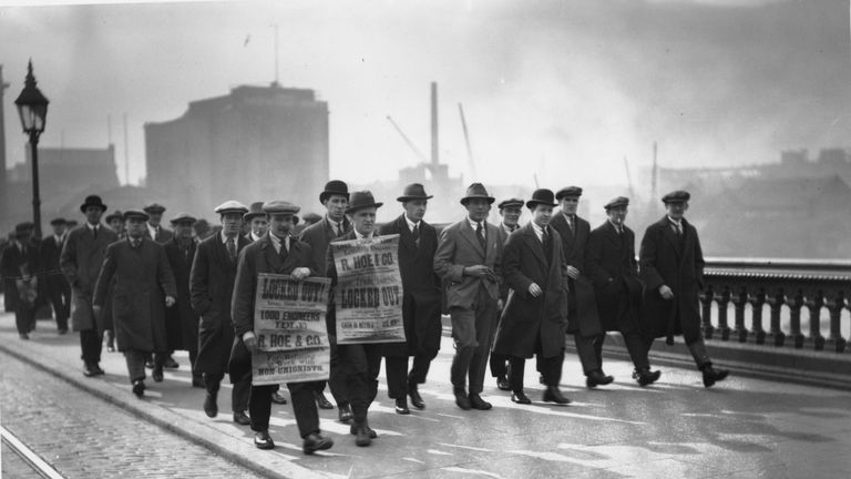 1926: Striking engineers crossing Blackfriars Bridge, London, on a march to Memorial Hall. (Photo by G. Adams/Topical Press Agency/Getty Images)