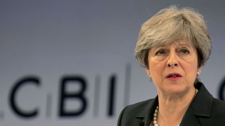 Theresa May speaks to business leaders at the CBI conference in east London