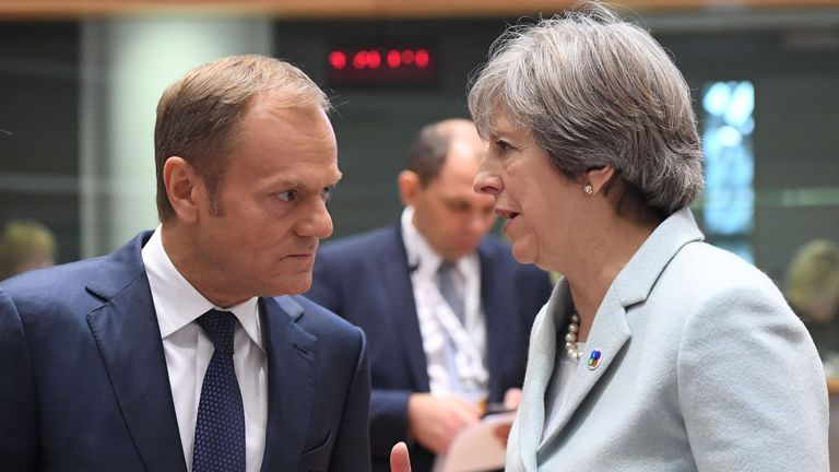 British Prime Minister Theresa May (R) speaks with European Council President Donald Tusk during an EU Eastern Partnership summit with six eastern partner countries at the European Council in Brussels on November 24, 2017