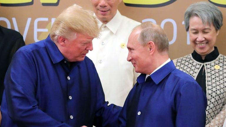 Donald Trump and Vladimir Putin shook hands at the APEC leaders' conference in Vietnam