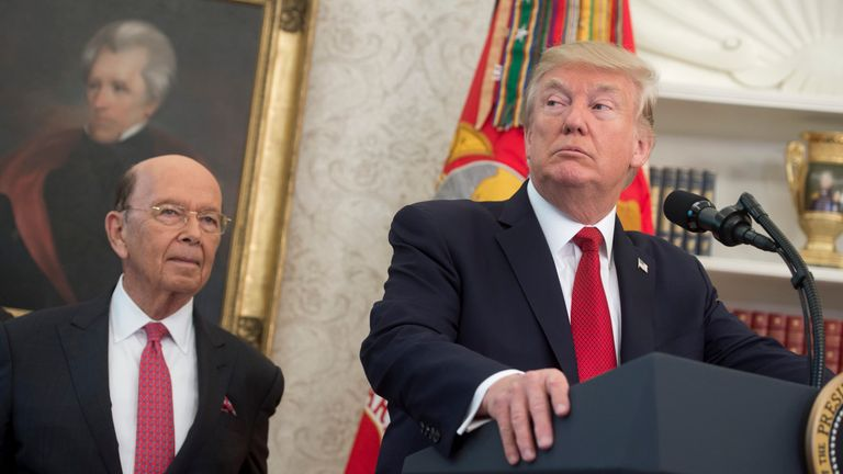 US President Donald Trump speaks alongside Secretary of Commerce Wilbur Ross