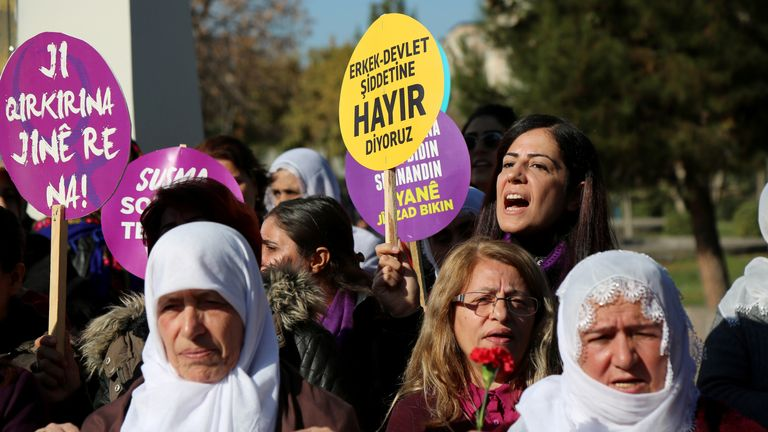 A demonstrator shouts slogans as she holds a placard during a gathering to mark the U.N. International Day for the Elimination of Violence Against Women in Diyarbakir, Turkey, November 25, 2017