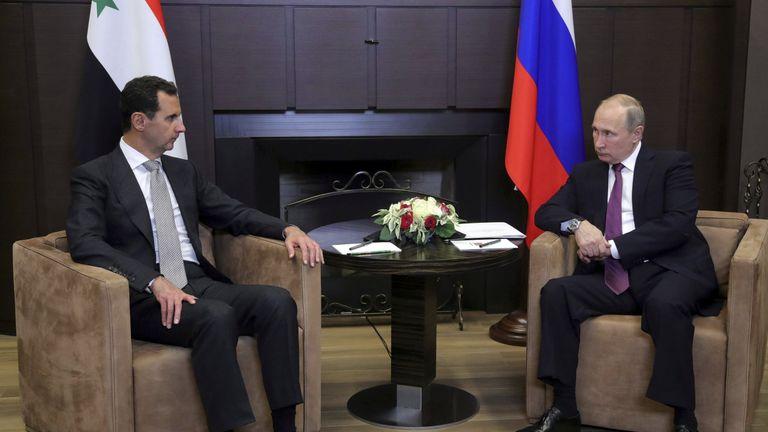 Vladimir Putin meets with Bashar al-Assad in the Black Sea resort of Sochi, Russia