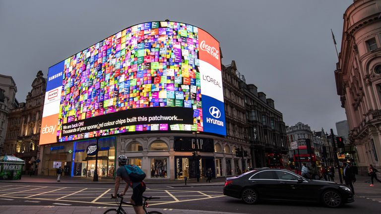 Piccadilly Circus lights are switched back on after a nine month renovation in London. The single 4K LED digital screen is the largest of its kind in Europe