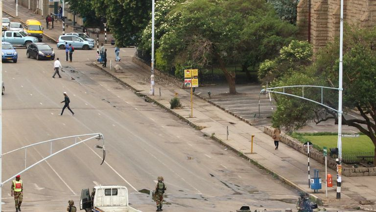 Soldiers stand on the streets in Harare, Zimbabwe