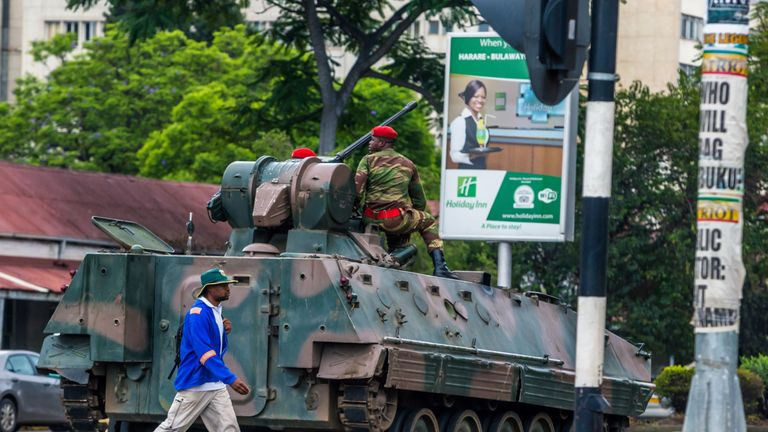 An armoured personnel carrier stationed by an intersection as Zimbabwean soldiers regulate traffic in Harare