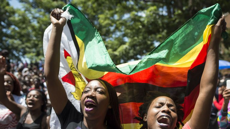 Hundreds have marched through Zimbabwe University calling on the president to resign