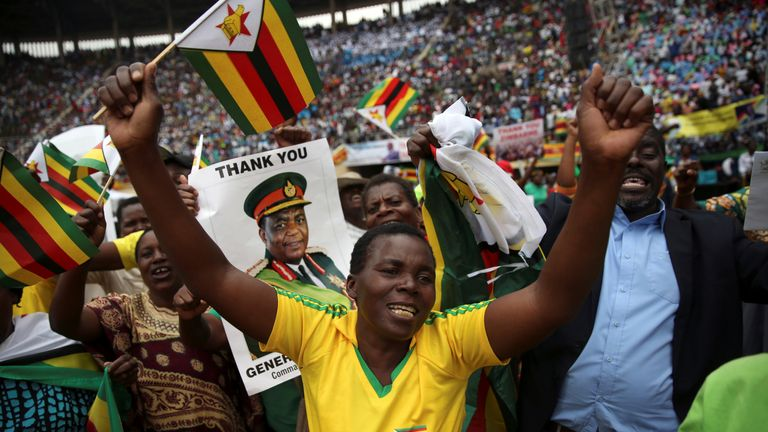 People cheer as Emmerson Mnangagwa is sworn in as Zimbabwe's president