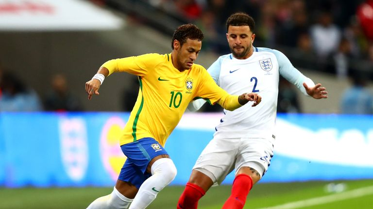LONDON, ENGLAND - NOVEMBER 14: Neymar Jr of Brazil and Kyle Walker of England battle for possession during the international friendly match between England