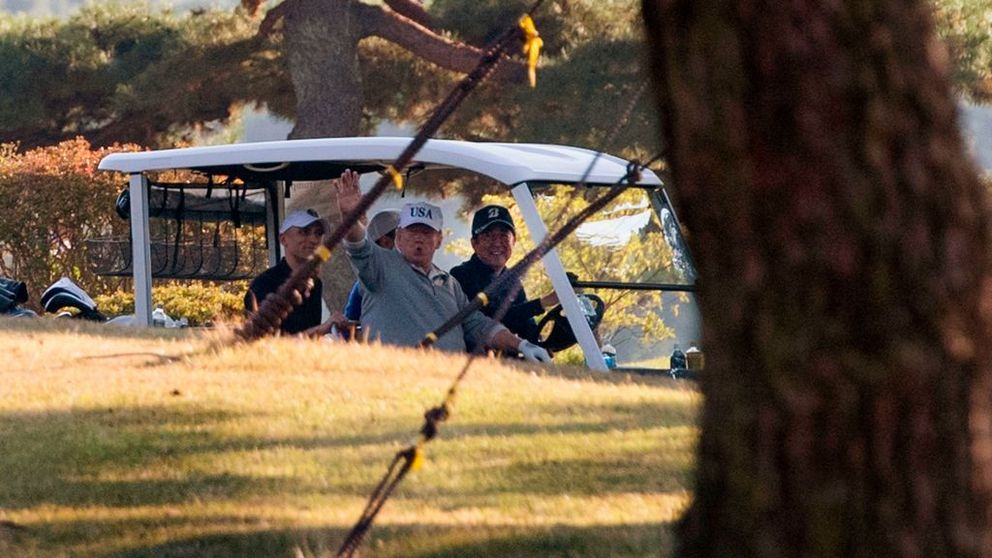 Donald Trump and Shinzo Abe in a golf cart after a round at the Kasumigaseki club in Kawagoe