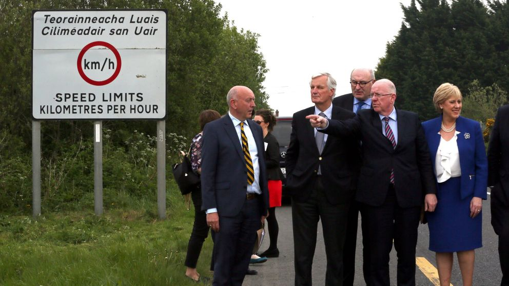 European Commission (EC) member in charge of Brexit negotiations with Britain, Michel Barnier (2nd L) is shown a border road in Co Monaghan between Republic of Ireland and Northern Ireland on May 12, 2017