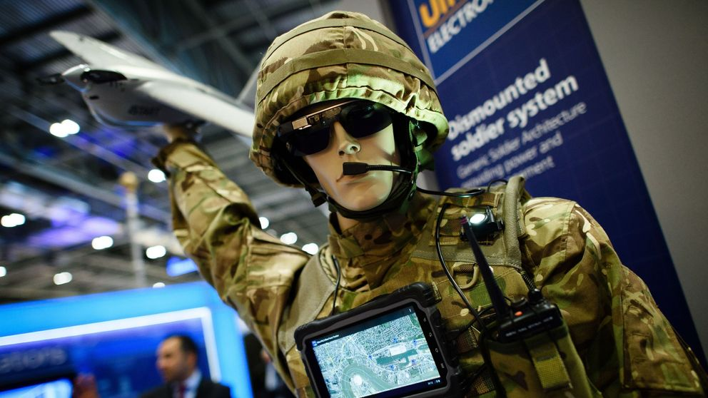 A mannequin dressed in combat fatigues displays a 'dismounted soldier system' created by Ultra Electronics, inside the ExCeL centre in London on September 15, 2015, during the Defence and Security Equipment International (DSEI) exhibition.