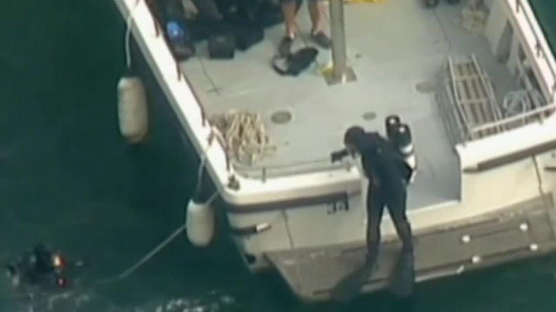 31 December: Divers search after crash
