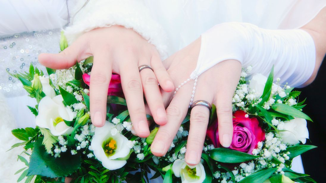 Newlywed women show their rings