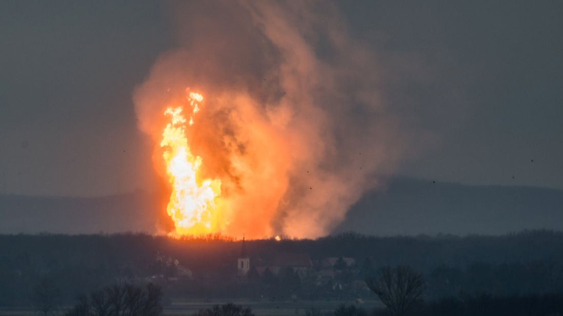 A column of fire is seen after an explosion ripped through Austria's main gas pipeline hub in Baumgarten