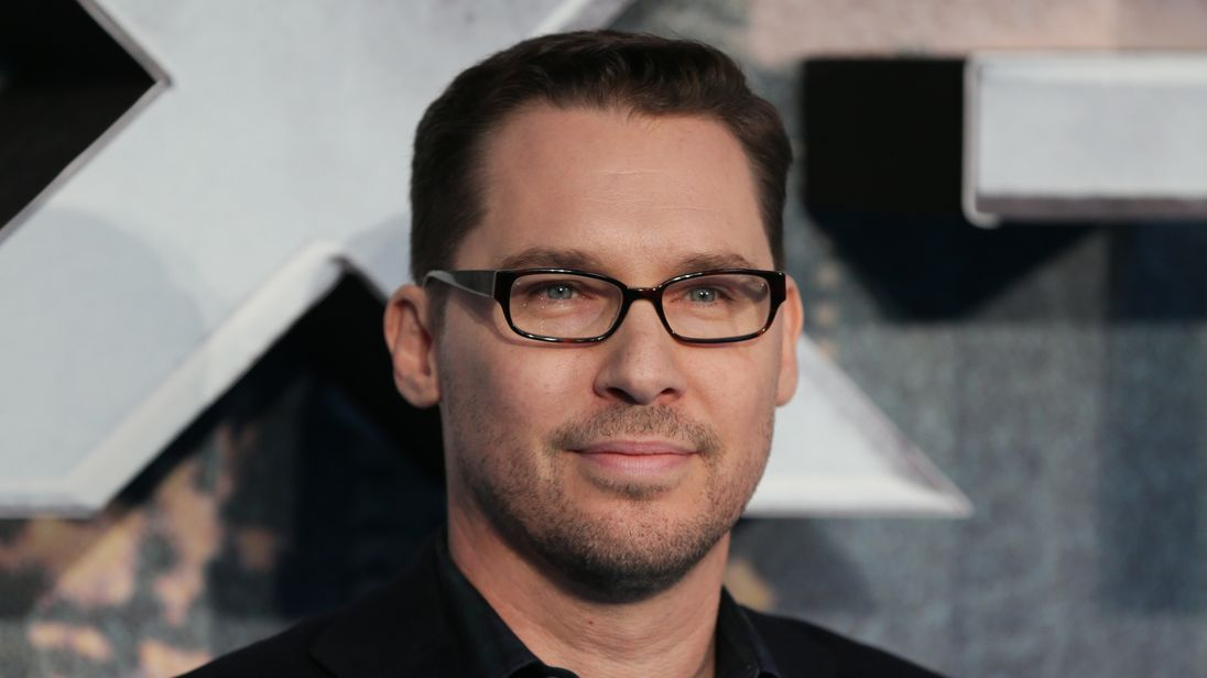 US director Bryan Singer poses on arrival for the premiere of X Men Apocalypse in central London