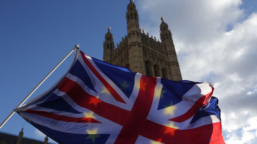 EU flag and Union flag outside Parliament