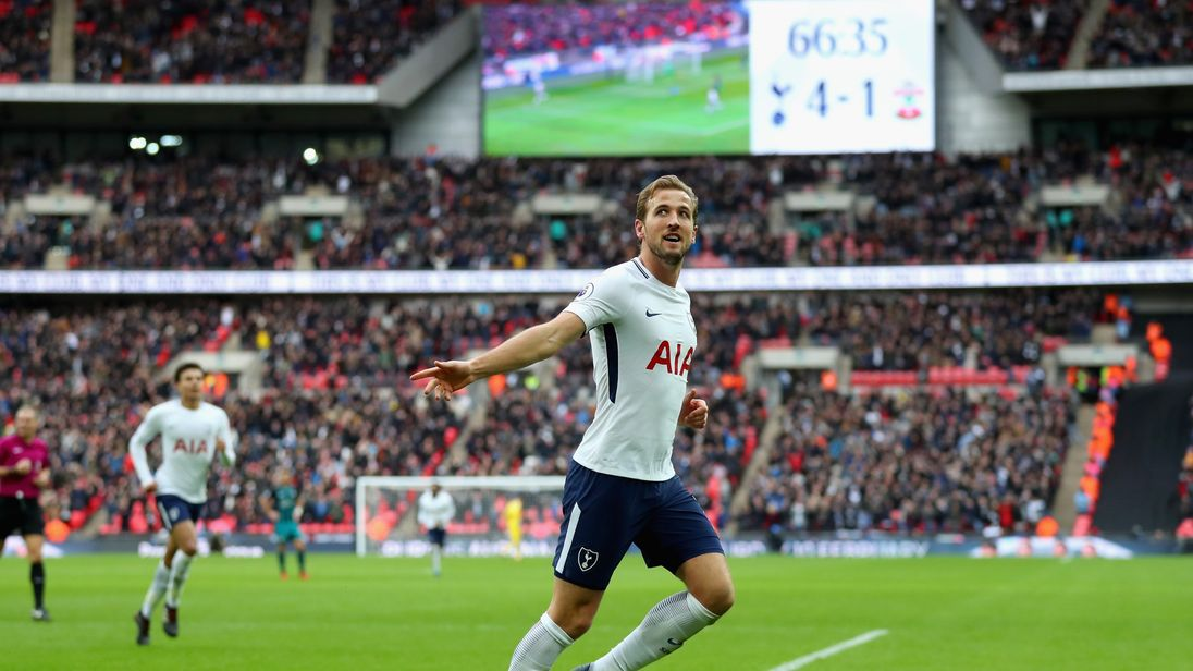 Harry Kane celebrates after scoring his side's fifth goal against Southampton at Wembley Stadium