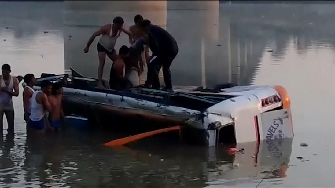 Rescue workers pull someone from the bus