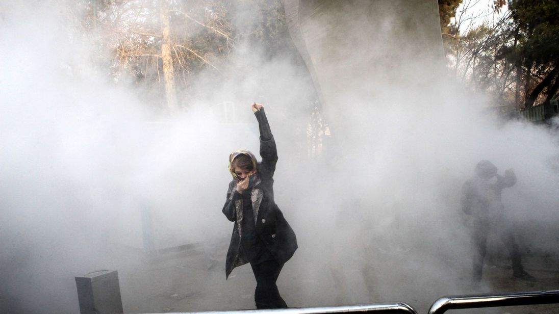 Iran plays down violent protests despite mounting death toll