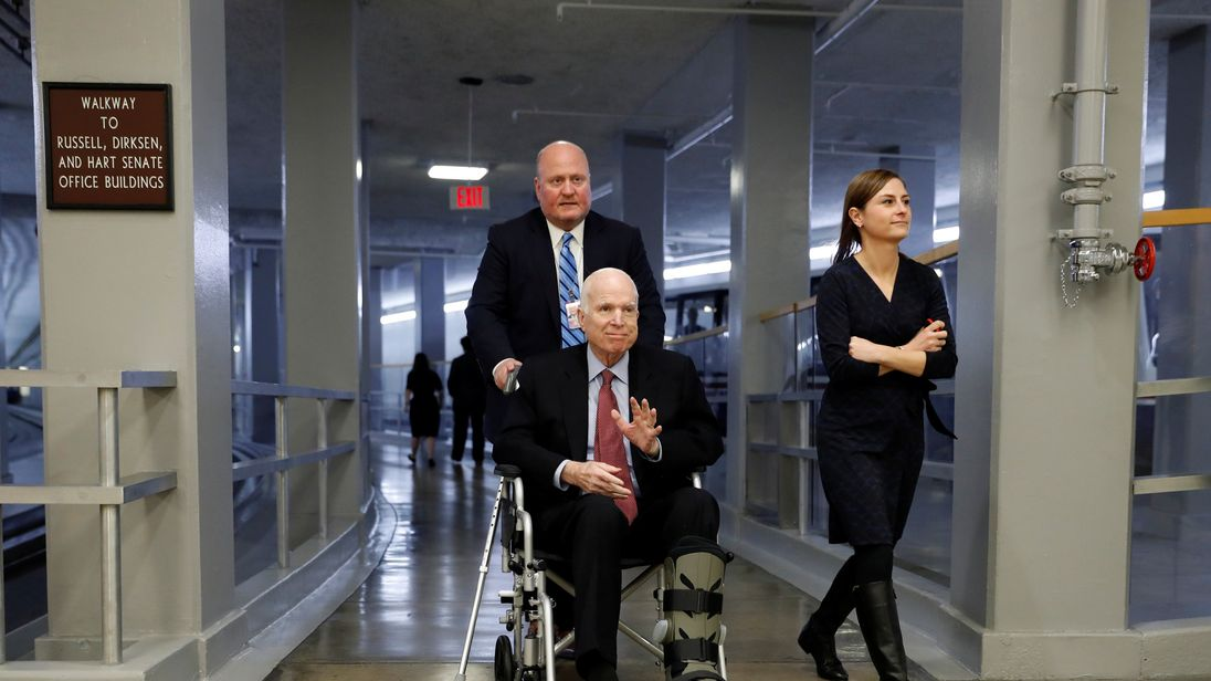 John McCain returns to Arizona after treatment, will miss tax bill vote