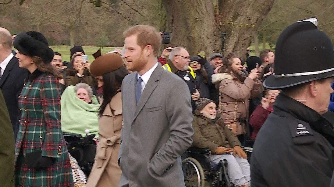 The newly engaged couple arrive at church arm-in-arm
