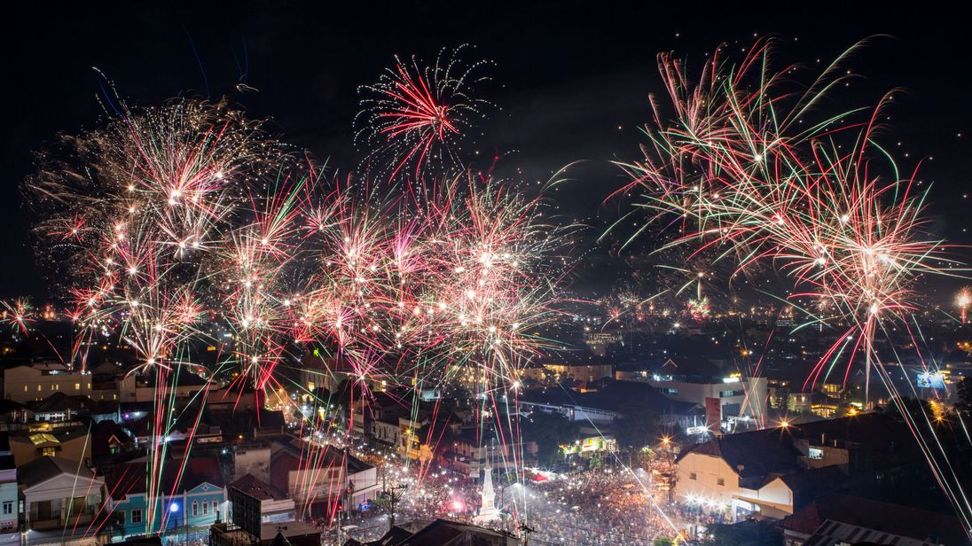 YOGYAKARTA, INDONESIA - JANUARY 01: Fireworks illuminate the city's skyline during New Year's Eve celebrations of 2018