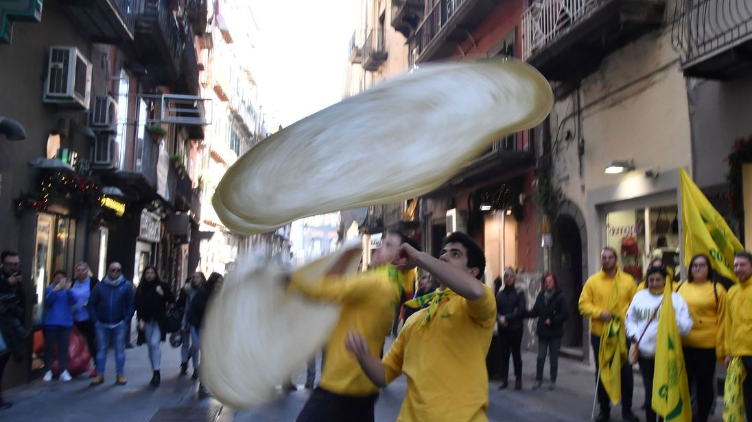 Pizzaiuoli have been celebrating the decision on the streets of Naples