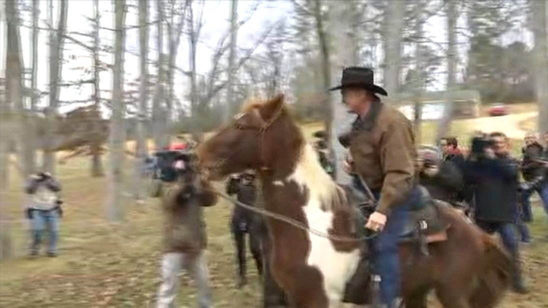 Roy Moore leaves the polling booth on horseback