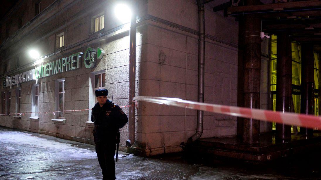 A police officer cordons off the site of a blast in a supermarket in Saint Petersburg on December 27, 2017. / AFP PHOTO / Olga MALTSEVA (Photo credit should read OLGA MALTSEVA/AFP/Getty Images)